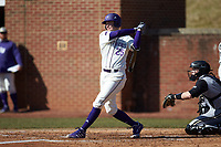 Cameron Irvine (25) of the High Point Panthers follows through on his swing against the Bryant Bulldogs at Williard Stadium on February 21, 2021 in  Winston-Salem, North Carolina. The Panthers defeated the Bulldogs 3-2. (Brian Westerholt/Four Seam Images)