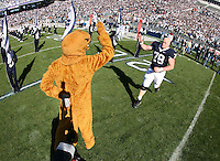 State College, PA -- 11/3/2007 --  The Nittany Lion congratulates senior offensive lineman John Shaw as he is recognized during Senior Day ceremonies before the game.  Penn State defeated Purdue by a score of 26-19 on Saturday, November 3, 2007, at Beaver Stadium...Photo:  Joe Rokita / JoeRokita.com