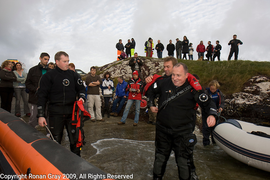 Saturday Oct 10 2009.  SCUBADIVE WEST, GALWAY, IRELAND:  Brothers Paul (L) and  Declan Devane don life jackets before boarding a boat to begin their world record attempt to be the first divers to stay underwater on SCUBA for a period of 24-hours.