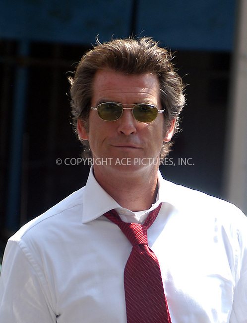 """Pierce Brosnan filming his new movie, """"The Laws of Attraction"""" in New York. August 14, 2003. Please byline: NY Photo Press.   ..*PAY-PER-USE*      ....NY Photo Press:  ..phone (646) 267-6913;   ..e-mail: info@nyphotopress.com"""