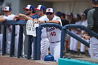 Kannapolis Cannon Ballers manager Guillermo Quiroz (40) watches from the dugout during the game against the Carolina Mudcats at Atrium Health Ballpark on June 13, 2021 in Kannapolis, North Carolina. (Brian Westerholt/Four Seam Images)