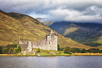 A view across the loch at the ruins of Kilchurn Castle Scotland