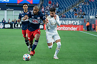 FOXBOROUGH, MA - MAY 1: Andrew Farrell #2 of New England Revolution and Marcelino Moreno #10 of Atlanta United FC battle for the ball near the New England goal line during a game between Atlanta United FC and New England Revolution at Gillette Stadium on May 1, 2021 in Foxborough, Massachusetts.