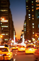 AVAILABLE FROM JEFF AS A FINE ART PRINT<br /> <br /> AVAILABLE FOR COMMERCIAL AND EDITORIAL LICENSING EXCLUSIVELY FROM GETTY IMAGES.  Please search for image # a0142-000209 on www.gettyimages.com<br /> <br /> Street Scene - Taxis on Seventh Avenue at Dusk, Blurred Motion, New York City, New York State, USA