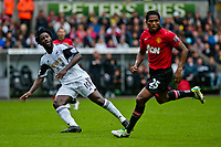 Saturday 17 August 2013<br /> <br /> Pictured: Wilfried Bony of Swansea and Antonio Valencia of Manchester United<br /> <br /> Re: Barclays Premier League Swansea City v Manchester United at the Liberty Stadium, Swansea, Wales