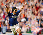 Milel Arteta celebrates scoring his penalty to seal the Championship for Rangers