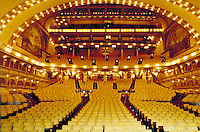 Interior of auditorium, theater in Roosevelt University, Chicago, looking from stage back towards seats. Designed by Louis Sullivan and Frank Lloyd Wright. Chicago Illinois United States.