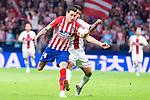 Atletico de Madrid Jose Maria Gimenez and SD Huesca Cucho Hernandez during La Liga match between Atletico de Madrid and SD Huesca at Wanda Metropolitano Stadium in Madrid, Spain. September 25, 2018. (ALTERPHOTOS/Borja B.Hojas)