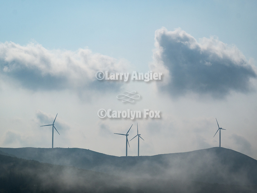 Windmills and fog her the Buzludzha Monument,  Central Balkan Mountains, Bulgaria.