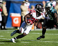 CHARLOTTE, NC - NOVEMBER 17: Kenjon Barner #38 of the Atlanta Falcons makes a run during a game between Atlanta Falcons and Carolina Panthers at Bank of America Stadium on November 17, 2019 in Charlotte, North Carolina.
