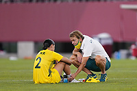 KASHIMA, JAPAN - AUGUST 5: Australia head coach Tony Gustavsson talks with Sam Kerr #2 after a game between Australia and USWNT at Kashima Soccer Stadium on August 5, 2021 in Kashima, Japan.