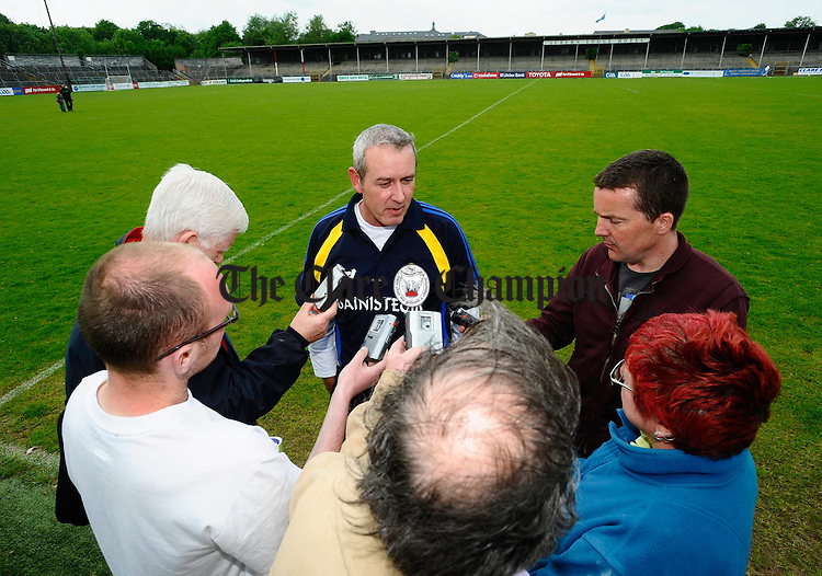 Clare manager Frank Doherty is the centre of attention for the media after the win over waterford. Photograph by John Kelly.