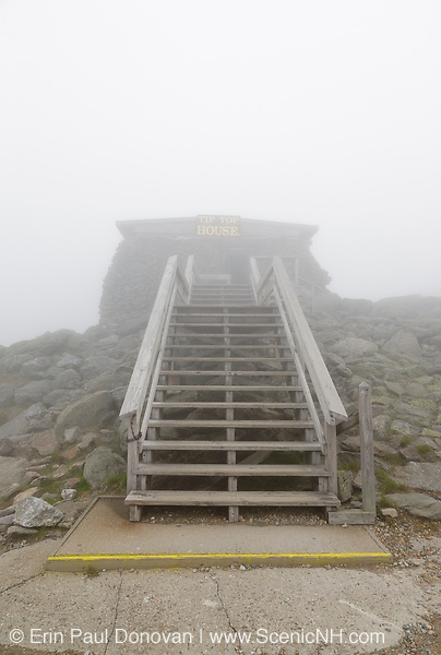 The Tip Top House (originally built as a hotel in 1853) on the summit of Mount Washington in the White Mountains, New Hampshire on a foggy summer day. Mount Washington, at 6,288 feet, is the tallest mountain in the northeastern United States.
