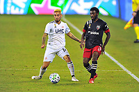 WASHINGTON, DC - SEPTEMBER 27: Diego Fagundez #14 of New England Revolution battles for the ball with Chris Odoi-Atsem #3 of D.C. United during a game between New England Revolution and D.C. United at Audi Field on September 27, 2020 in Washington, DC.