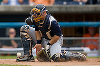 Catcher Dusty Ryan #13 of the Toledo Mudhens blocks a throw to the plate at Harbor Park June 7, 2009 in Norfolk, Virginia. (Photo by Brian Westerholt / Four Seam Images)