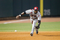 Carolina Mudcats third baseman Yandy Diaz (9) charges a ground ball during the game against the Winston-Salem Dash at BB&T Ballpark on June 6, 2014 in Winston-Salem, North Carolina.  The Mudcats defeated the Dash 3-1.  (Brian Westerholt/Four Seam Images)