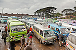 Matatus line up to collect passengers in the busy Railways terminus in Nairobi, Kenya.