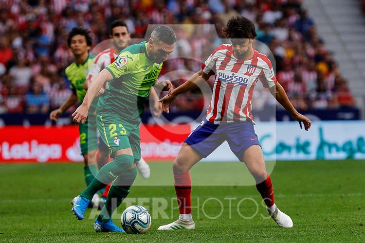 Joao Felix of Atletico de Madrid and Anaitz Arbilla of SD Eibar in action during La Liga match between Atletico de Madrid and SD Eibar at Wanda Metropolitano Stadium in Madrid, Spain.September 01, 2019. (ALTERPHOTOS/A. Perez Meca)