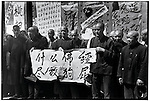 """As part of the monk's self-criticism, they are forced to hold a banner that reads, """"To hell with the Buddhist scriptures. They are full of dog farts."""" Harbin, 24 August 1966"""
