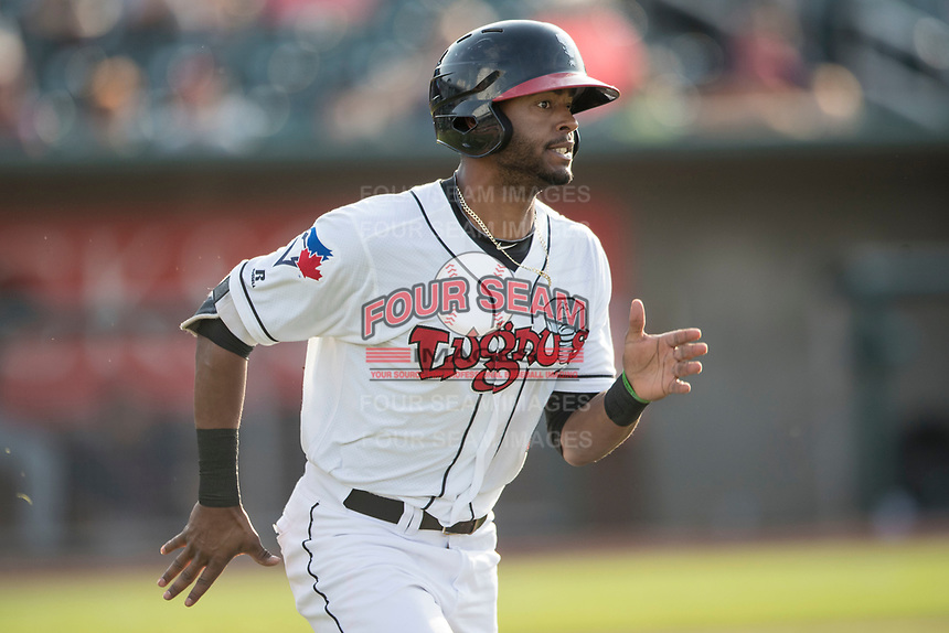 Lansing Lugnuts outfielder Joshua Palacios (5) runs to first base during the Midwest League baseball game against the Bowling Green Hot Rods on June 29, 2017 at Cooley Law School Stadium in Lansing, Michigan. Bowling Green defeated Lansing 11-9 in 10 innings. (Andrew Woolley/Four Seam Images)
