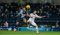 Sam Wood of Wycombe Wanderers & Graham Burke of Notts County battle during the Sky Bet League 2 match between Wycombe Wanderers and Notts County at Adams Park, High Wycombe, England on 15 December 2015. Photo by Andy Rowland.