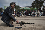 © Remi OCHLIK/IP3 - Benghazi - Civilians attempt to quick military training to basic weapons such as Kalachnikov, Katioucha, Douchka, 12,7 in order to go to the front to fight Kaddhafi forces