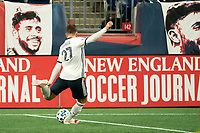 FOXBOROUGH, MA - OCTOBER 19: Kai Wagner #27 of Philadelphia Union takes a shot towards the New England goal during a game between Philadelphia Union and New England Revolution at Gillette on October 19, 2020 in Foxborough, Massachusetts.
