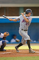 Darrell Ceciliani #20 of the Kingsport Mets follows through on his swing versus the Burlington Royals at Burlington Athletic Park July 3, 2009 in Burlington, North Carolina. (Photo by Brian Westerholt / Four Seam Images)