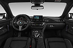 Stock photo of straight dashboard view of a 2018 BMW M4 M4 CS 2 Door Coupe