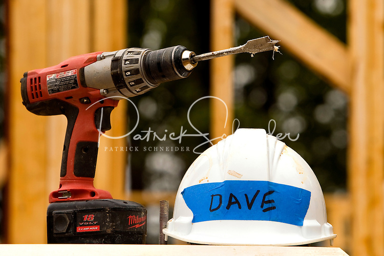Construction illustration of drill and hardhat.