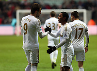 Saturday 19 January 2013<br /> Pictured: Jonathan de Guzman of Swansea (R) celebrating his goal with team mate Michu (L).<br /> Re: Barclay's Premier League, Swansea City FC v Stoke City at the Liberty Stadium, south Wales.