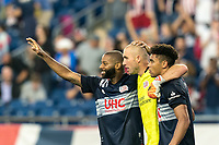 FOXBOROUGH, MA - JULY 25: Andrew Farrell #2 of New England Revolution, Brad Knighton #18 of New England Revolution, and Brando Bye #15 of New England Revolution celebrate the victory after a game between CF Montreal and New England Revolution at Gillette Stadium on July 25, 2021 in Foxborough, Massachusetts.