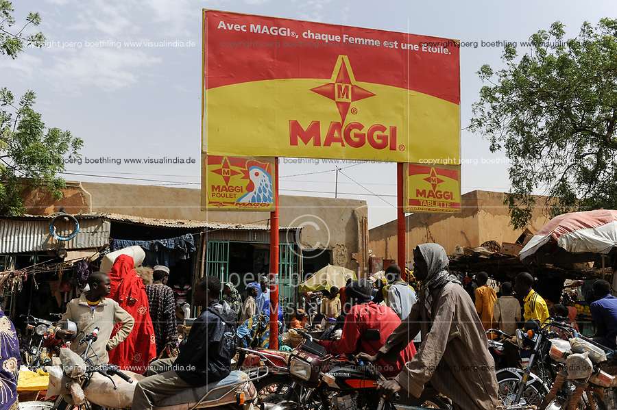 NIGER Zinder, market, advertisement billboard for Maggi bouillon cube a brand of swiss multinational company Nestle