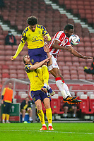 21st November 2020; Bet365 Stadium, Stoke, Staffordshire, England; English Football League Championship Football, Stoke City versus Huddersfield Town; John Obi Mikel of Stoke City is hit in the face by the ball as he challenges for a header