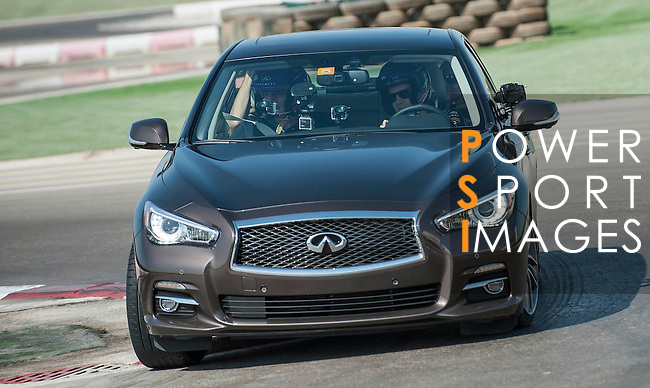 Infiniti Red Bull Racing driver Sebastian Vettel of Germany attends media event with Infiniti Q50 car at Al Forsan International Sports Resort in Abu Dhabi, UAE, on October 31, 2013. Photo by Victor Fraile / The Power of Sport Images