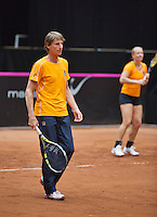 The Netherlands, Den Bosch, 16.04.2014. Fed Cup Netherlands-Japan, training, captain Paul Haarhuis with in the background Kiki Bertens<br /> Photo:Tennisimages/Henk Koster