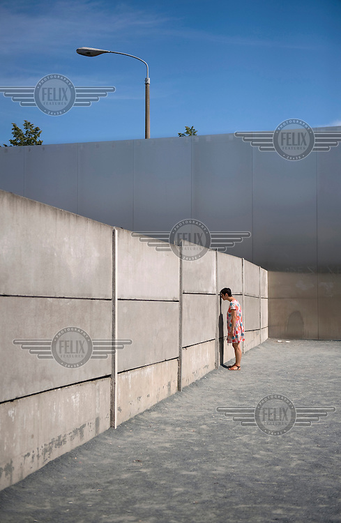 A tourist at the Berlin Wall Memorial.