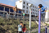 Tibetan children play in a playground in a community on the Tibetan Plateau, in western China.