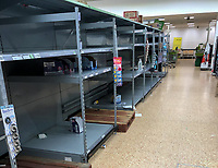 Empty shelves in Asda superstore in High Wycombe as the Coronavirus (COVID-19) continues worldwide on 16 March 2020. Photo by Andy Rowland.