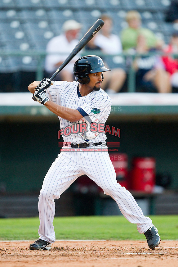 Marcus Semien (3) of the Charlotte Knights at bat against the Lehigh Valley IronPigs at Knights Stadium on August 6, 2013 in Fort Mill, South Carolina.  The IronPigs defeated the Knights 4-1.  (Brian Westerholt/Four Seam Images)