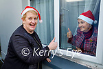 Mairead Hanlon from the Ard Chúram Day Care Centre in Listowel paying a visit to Dolores Carroll to wish her a Happy Christmas