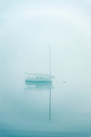 Sailboat in foggy weather, Maine, USA