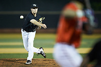 Wake Forest Demon Deacons relief pitcher Antonio Menendez (27) delivers a pitch to the plate against the Virginia Cavaliers at David F. Couch Ballpark on May 18, 2018 in  Winston-Salem, North Carolina.  The Cavaliers defeated the Demon Deacons 15-3.  (Brian Westerholt/Four Seam Images)
