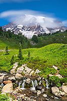 Always trying to capture more than just a snap shot of a common scene, I took this two-minute exposure of the clouds moving around the peak of Mount Rainier.  This view is reached by a short paved walk-way.