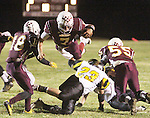 CHAD PILSTER •Hays Daily News<br /> <br /> Osborne High School's Jake Tiernan (7) dives over a defender on Tuesday, November 5, 2013, during the KSHSAA Bi-District Football playoffs at Osborne High School in Osborne, Kansas. Osborne defeated Madison 40-34.