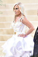 """NEW YORK, NEW YORK - SEPTEMBER 13: Donatella Versace at the 2021 Met Gala benefit """"In America: A Lexicon of Fashion"""" at Metropolitan Museum of Art on September 13, 2021 in New York City. Credit: John Palmer/MediaPunch"""