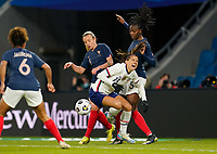 LE HAVRE, FRANCE - APRIL 13: Alex Morgan #13 of the United States gets clobbered by Aïssatou Tounkara of France during a game between France and USWNT at Stade Oceane on April 13, 2021 in Le Havre, France.