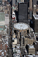 aerial photograph Pennsylvania Station with a view down 8th Avenue, Manhattan, New York City after a snow storm