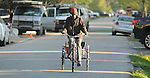 Richard Perry rides his new tricycle down Waverly Street in the Heights Tuesday March 24, 2015. The bike was donated by neighbors after his last bike was stolen.(Dave Rossman photo)