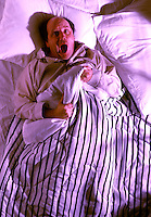 Abstract of man in bed scared and frustrated that he worries and can not sleep balding man.